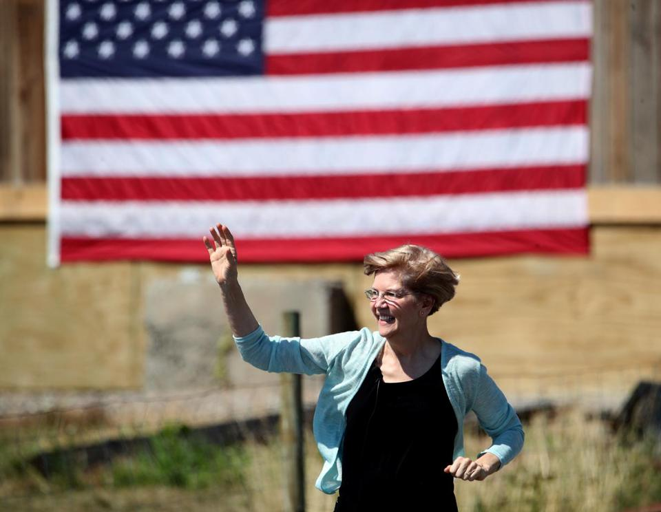 Senator Elizabeth Warren greeted the crowd as she ran down from the main house to the event at Belkin Family Lookout Farm.